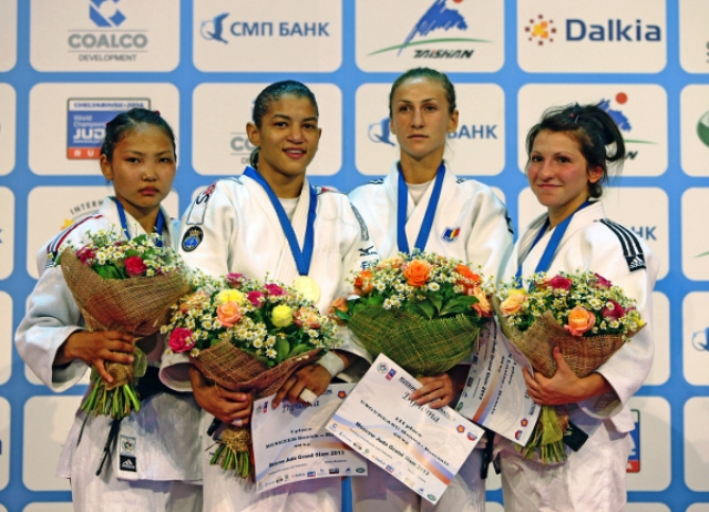 Olympic champion Sarah Menezes of Brazil second from left defended her Moscow Judo Grand Slam title