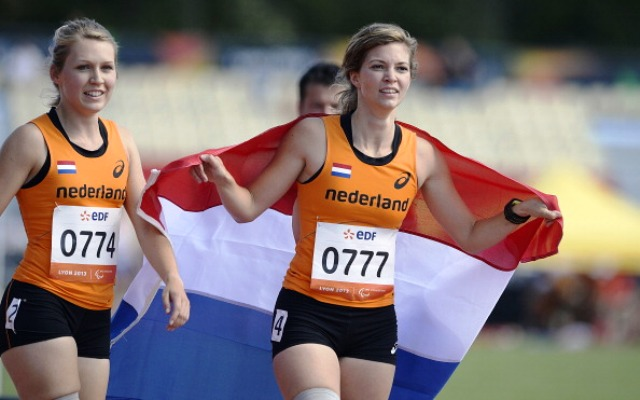 Paralympic champion Marlou van Rhijn right celebrates her sprint double in Lyon