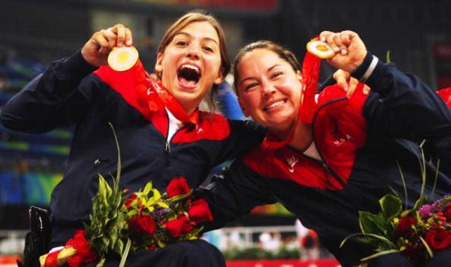 Paralympic skiier Alana Nicholls rightcelebrates winning wheelchair basketball gold at the Beijng Summer Olympics 2008