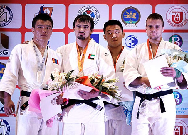 Segiu Toma second from left won the UAEs first ever interbational judo gold medal in the mens -81kg category