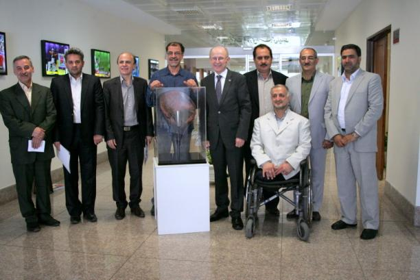 Wilfried Lemke poses with members of Irans National Paralympic Committee
