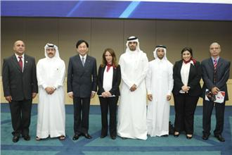 Wu poses with the Doha 2015 delegation