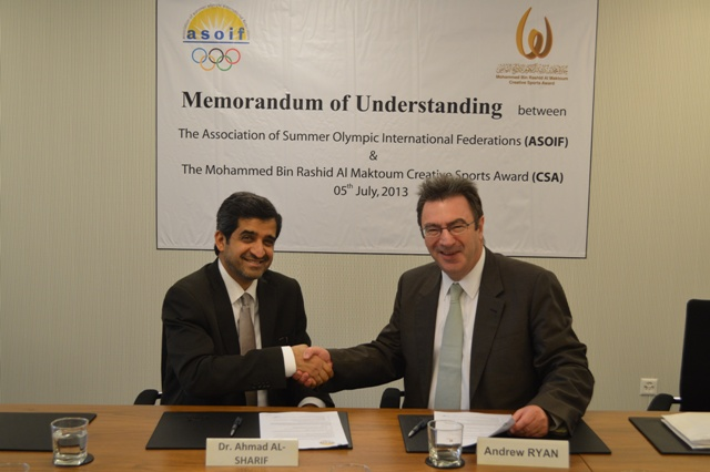 Andrew Ryan and Dr Ahmad Al-Sharif sign cooperation agreement