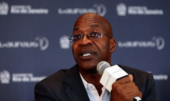 Edwin Moses talking into microphone