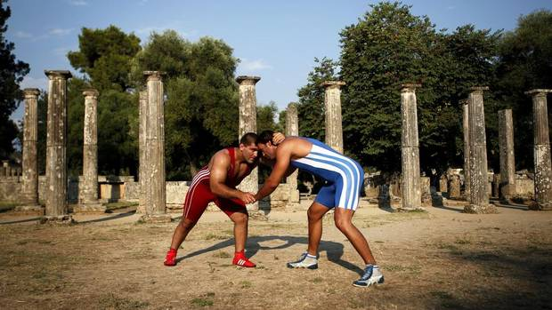 Greek wrestlers promote their sport in ancient Olympia
