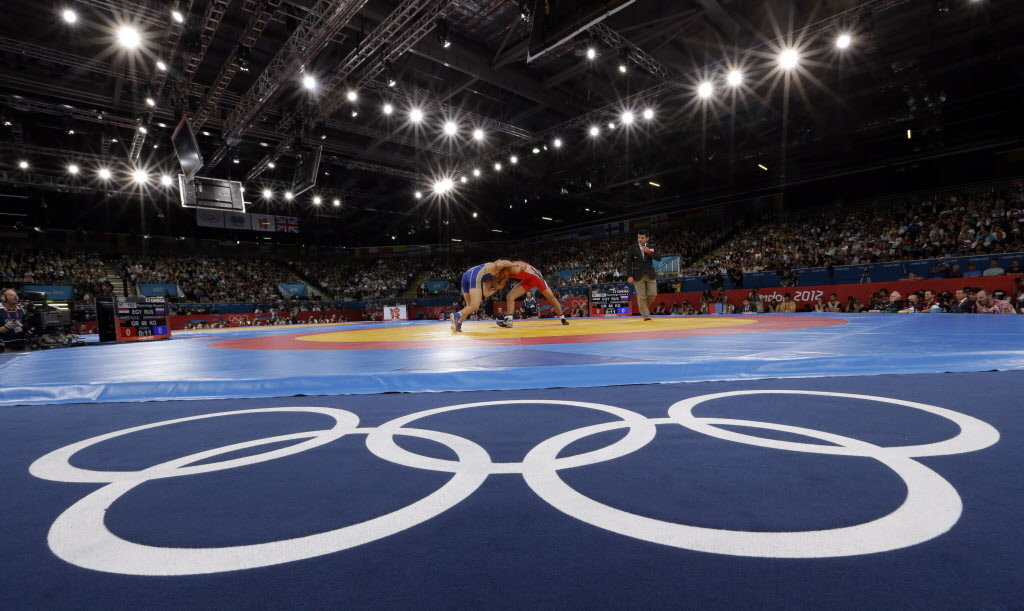Olympic wrestling is up against baseball-softball and squash for a place on the 2020 Olympic sports programme