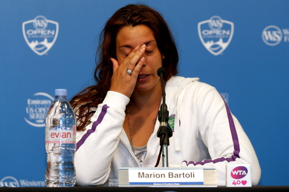 Marion Bartoli announced her retirement because of persistent injuries following her second round defeat in the Western and Southern Open in Cincinnati