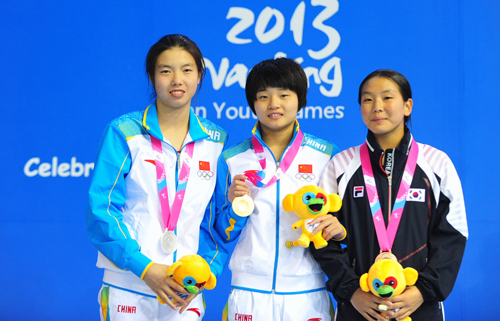 China led the way with two gold and two silver medals in diving, with Yi Shen taking gold ahead of Weiiie Wang (left) as South Korea's Kim Suji took bronze