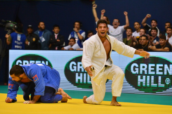 Cuba's Asley Gonzalez (white) celebrates after defeating Greece's Ilias Iliadis in the men's under 90kg category semi-final on his way to winning the title