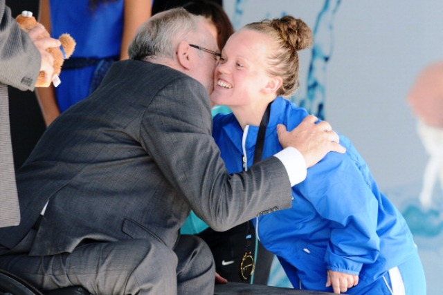Ellie Simmonds of Graet Britain receives her gold medal from IPC President Sir Phillip Craven in Montreal
