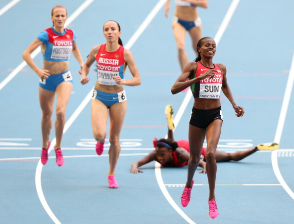 Eunice Jepkoech Sum of Kenya crosses the line to win gold ahead of Russia's Mariya Savinova in the women's 800 metres final at the World Championships