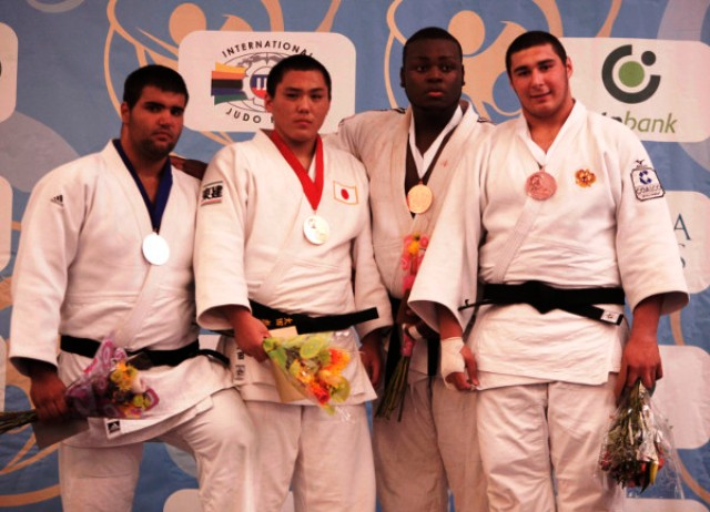 Hyoga Ota of Japan second left earned his countrys fifth gold medal at the World Cadet Championships in Miami