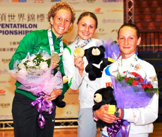 Lithuanian Laura Asadauskaite centre added the World Championship title to her Olympic gold