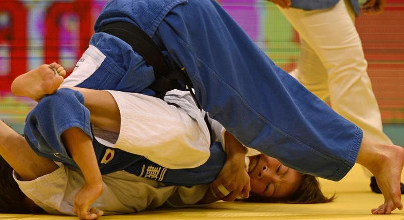 Mönkhbatyn Urantsetseg denied Japan's Haruna Asami a third consecutive world title with a brilliant performance in Rio de Janeiro
