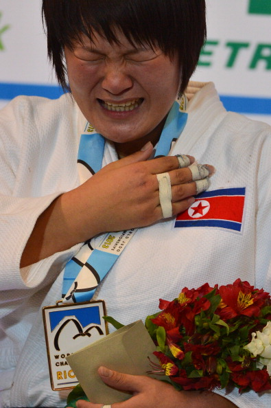 North Korea's new champion Kyong Sol cries on the podium during the medal ceremony for the women'sunder 78kg category
