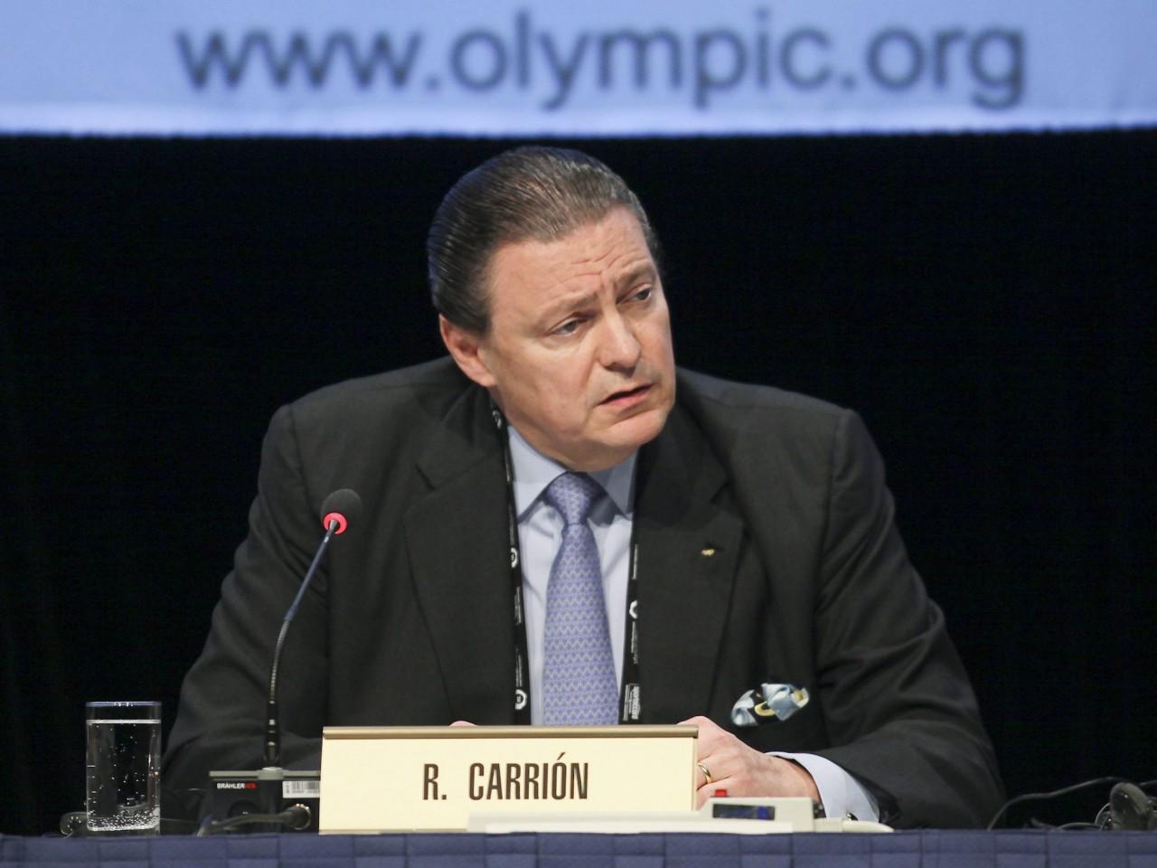 Richard Carrión behind name badge