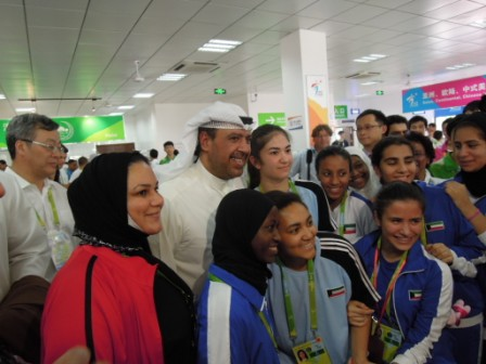 Sheikh Ahmad poses with competitors from his own country of Kuwait in the Athletes' Village