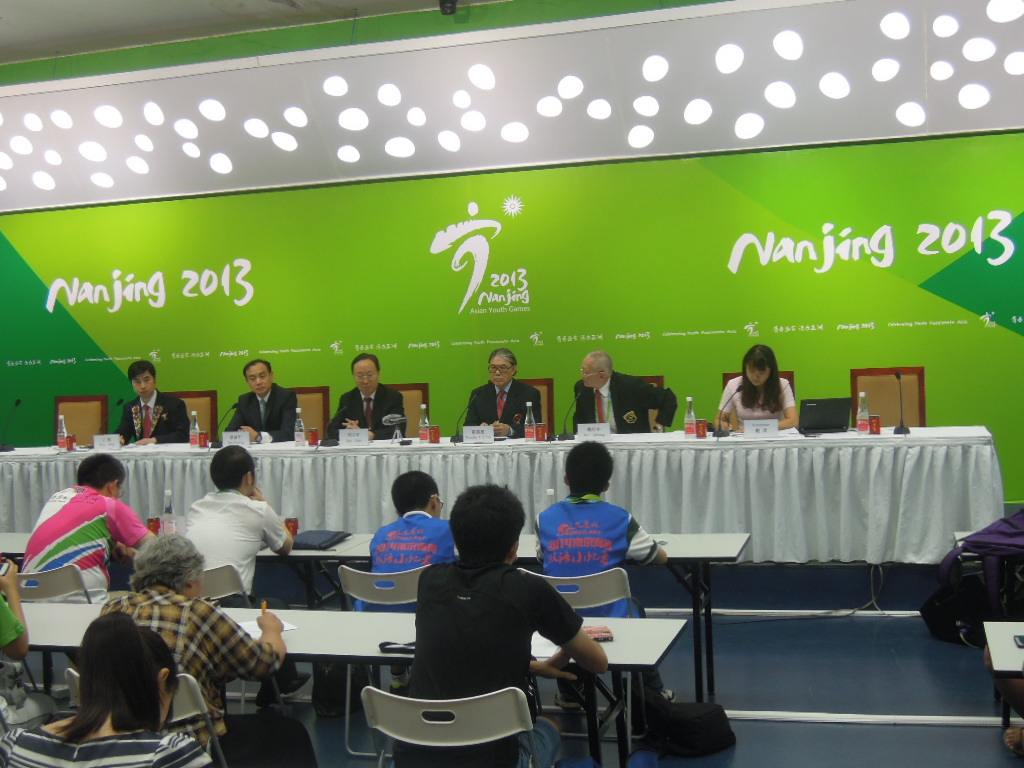OCA vice-president Timothy Fok (fourth left) and honorary vice-president Wei Jizhong (second right) speaking on the final day of the Asian Youth Games