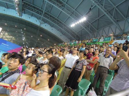 The home crowd getting behind their team at the Asian Youth Games