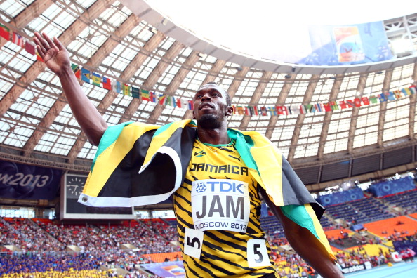 Usain Bolt celebrates his third gold medal of the IAAF World Championships in Moscow after anchoring Jamaica to victory in the 4x100 metres relay