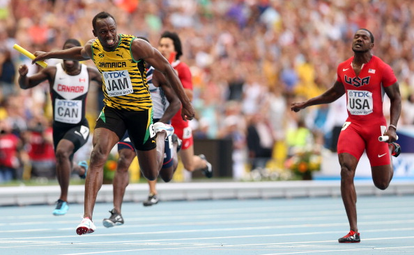 Usain Bolt holds off America's Justin Gatlin to anchor Jamaica to the gold medal in the 4x100 metres relay at the World Championships in Moscow