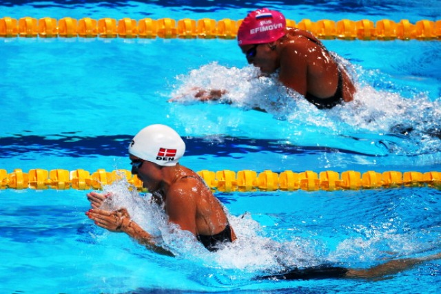 World record holder Rikke Pedersen of Denmark left and Russian Yulia Efimova battle it out in the final of the 200m breaststroke