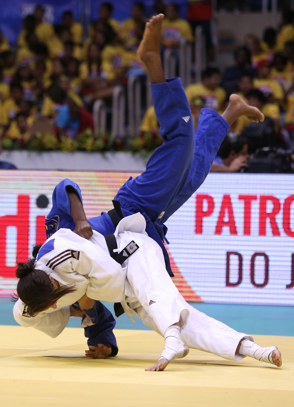 Yarden Gerbi left France's Clarisse Agbegnenou with a dislocated shoulder in the final of the women's under 63 kilogram category as she claimed Israel's first ever gold medal at the World Championships