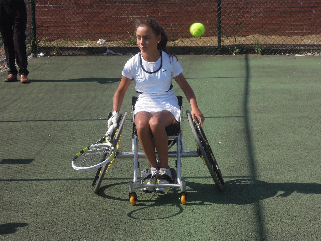 Young wheelchair tennis player Luz Esperanza Merry in action