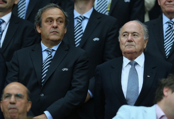 Michel Platini (left) is considering whether to challenge Sepp Blatter (right) for FIFA Presidency