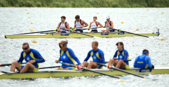 Britain (background) have won the para-rowing mixed coxed four world title in South Korea