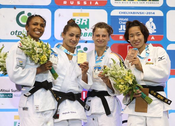 Kosovo's Majlinda Kelmendi (second left) proudly shows off the gold medal she won at the judo World Championships, along with Brazil's silver medallist Erika Miranda (left) and bronze medallists Mareen Kraeh (second right) and Japan's Yuki Hashimoto (right)