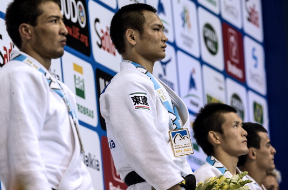 Gold medalist Japan's Masashi Ebinuma (second left), silver medalist Kazakhstan's Azamat Mukanov (left), and bronze medalists Ukraine's Georgii Zantaraia (right) and Japan's Masaaki Fukuoka pose on the medal podium
