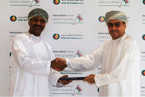 Ahmed Al Musalmi of the National Bank of Oman (left) shakes hands on the new spnsorship agreement with Mulham Al Jarf of the Oman Oil Company