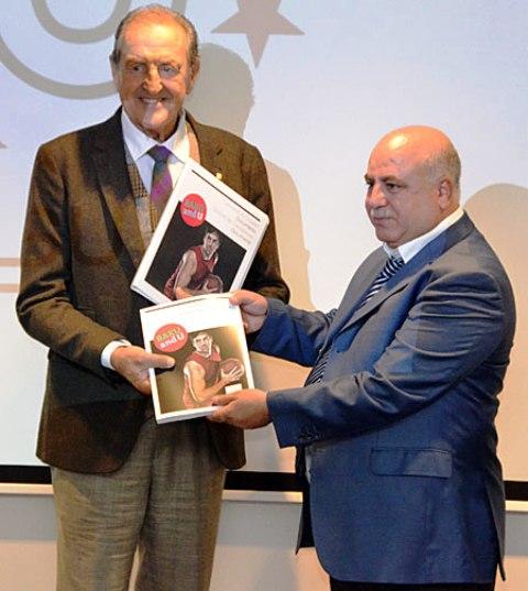 Azerbaijan's NUSF President Tofig Khanaliyev (right) presents Baku's 2019 dossier to FISU President Claude-Louis Gallien