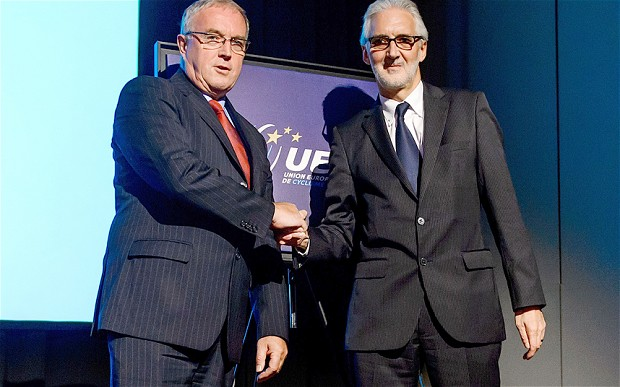 Pat McQuaid (left) and Brian Cookson (right) shake hands after their debate at the European Cycling Union Exceptional Ordinary General Assembly