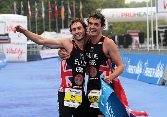 Dave Ellis (left) and his guide Luke Watson show their delight after winning the Tr1-6b category at the 2013 World Paratriathlon Championships in London