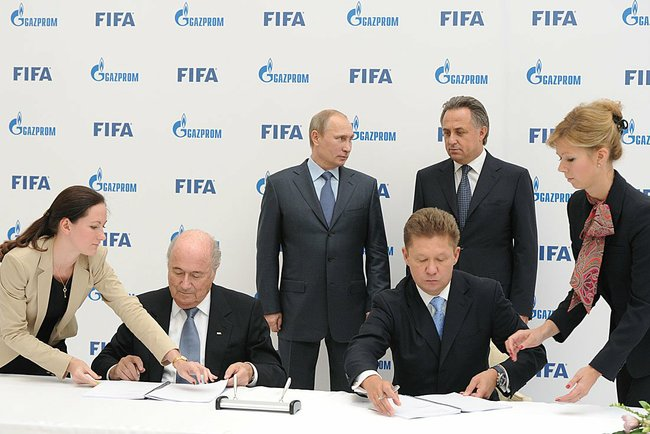 A four-year deal between FIFA and Gazprom is clinched as Russian President Vladimir Putin looks on