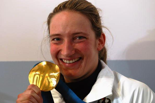 Germany's Olympic luge champion Tatjana Huefner posing with her Vancouver 2010 gold medal