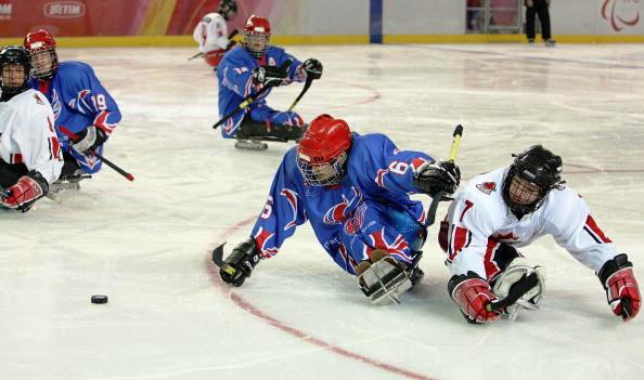 Great Britain's Karl Nicholson (centre) will be hoping to make it to another Parlympics in Sochi