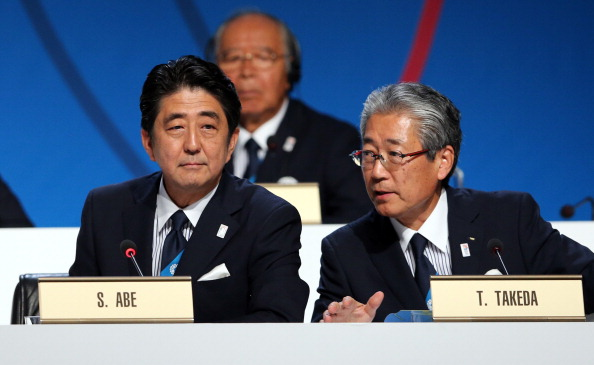 Japan's Prime Minister Shinzo Abe and President of the Tokyo 2020 Committee Tsunekazu Takeda speak during the Tokyo 2020 bid presentation
