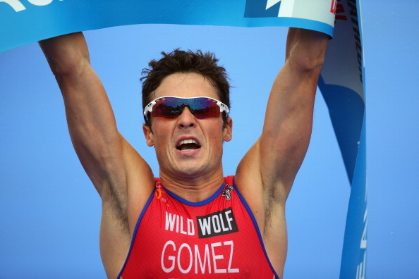 Javier Gomez celebrates after securing his third triathlon world title in London