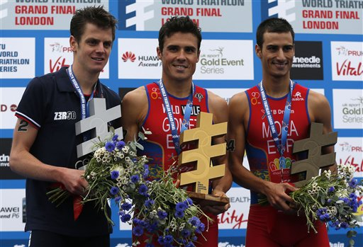 Javier Gomez flanked by Jonny Brownlee and Mario Mola on the world championship podium in London