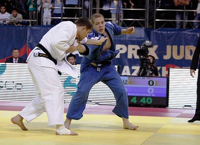 Kazakhstan's star man Maxim Rakov (white) proved too strong for his Brazilian rival Rafael Buzacarini in the -100kg category