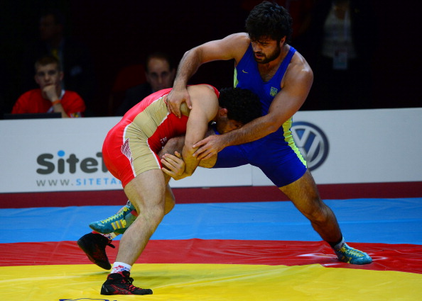 Khadzhimurat Gatsalov (red) secured his fifth world title by defeating Alen Zaseev (blue)