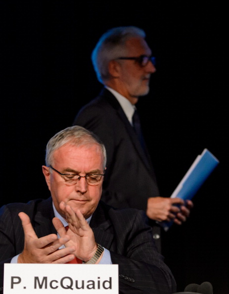 UCI President Pat McQuaid applauds after British rival Brian Cookson has finished delivering his presentation to the European Cycling Union in Zürich-Regensdorf