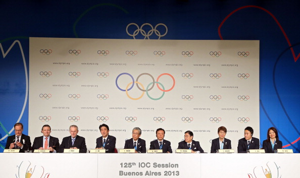 President Rogge alongside the victorious Tokyo 2020 bid team following the announcement of their victory
