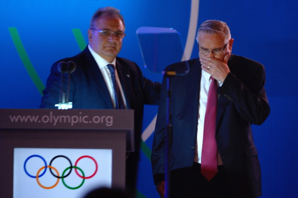 Riccardo Fraccari comforts Don Porter, his co-President of the World Baseball Softball Confederation, following an emotional pitch to the IOC to try to get the sports back on the Olympic programme
