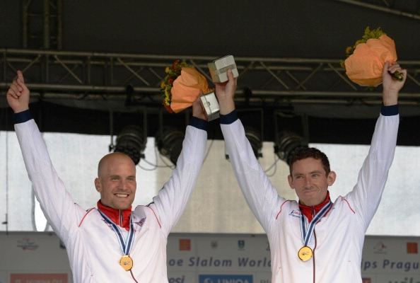 Richard Hounslow and David Florence right raise their arms in celebration after receiving their World Championship gold medals in Prague