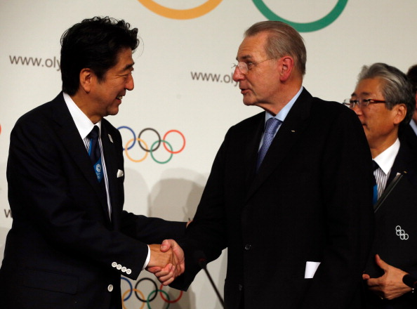 Japanese Prime Minister Shinzo Abe is congratulated by IOC President Jacques Rogge after Tokyo is awarded the 2020 Olympics and Paralympics
