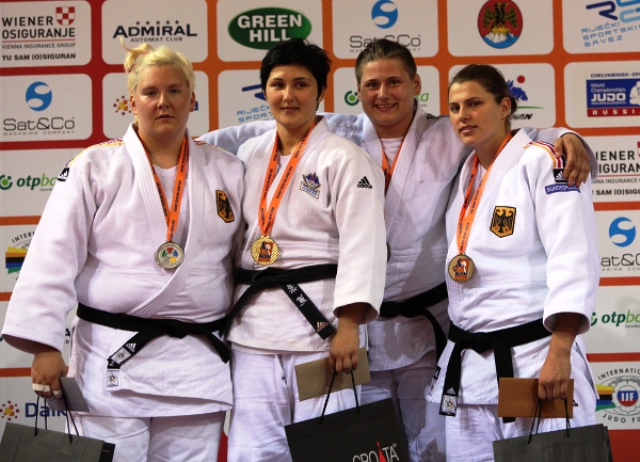 Slovenias Lucija Polavder (second from left) celebrates with her gold medal and female athlete of the tournament award